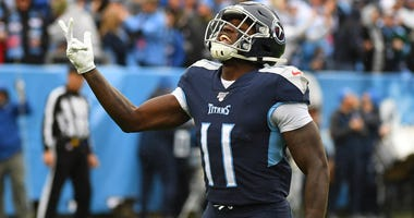 Tennessee Titans wide receiver A.J. Brown (11) celebrates after a touchdown during the first half against the New Orleans Saints at Nissan Stadium.