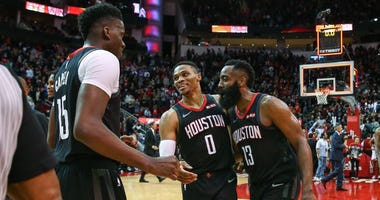 Houston Rockets center Clint Capela (15) and guard Russell Westbrook (0) and guard James Harden (13) celebrate after the game against the San Antonio Spurs at Toyota Center.