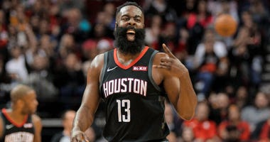 Houston Rockets guard James Harden (13) celebrates a made three-point basket against the Denver Nuggets during the fourth quarter at Toyota Center.