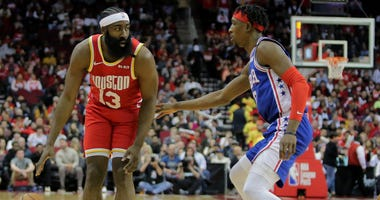 Houston Rockets guard James Harden (13) handles the ball against Philadelphia 76ers guard Josh Richardson (0) during the first quarter at Toyota Center.
