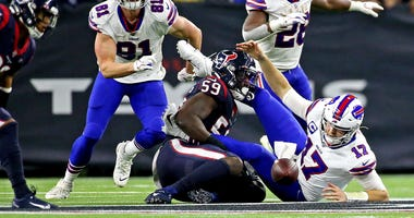 Buffalo Bills quarterback Josh Allen (17) fumbles the ball against Houston Texans outside linebacker Whitney Mercilus (59) during the fourth quarter in the AFC Wild Card NFL Playoff game at NRG Stadium.