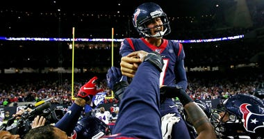 Houston Texans kicker Ka'imi Fairbairn (7) celebrates with teammates after kicking the game winning field goal to beat the Buffalo Bills in the AFC Wild Card NFL Playoff game at NRG Stadium.