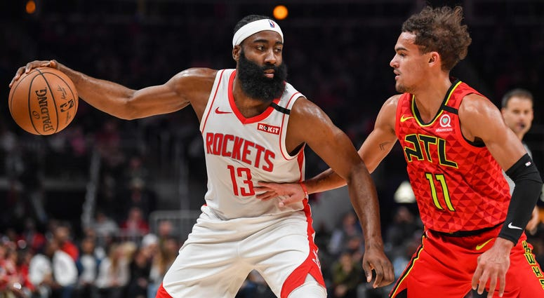 Houston Rockets guard James Harden (13) works against shoots Atlanta Hawks guard Trae Young (11) during the first half at State Farm Arena.