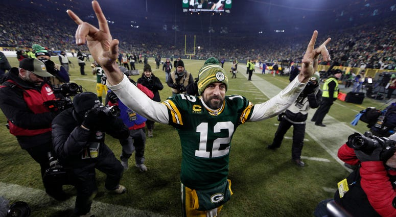 Green Bay Packers quarterback Aaron Rodgers (12) waves as he walks off the field after defeating the Seattle Seahawks in a NFC Divisional Round playoff football game at Lambeau Field.
