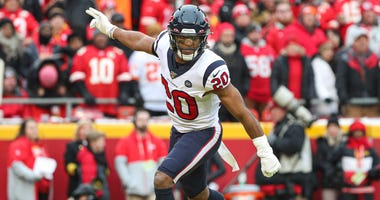 Houston Texans strong safety Justin Reid (20) celebrates after a touchdown against the Kansas City Chiefs during the first half in a AFC Divisional Round playoff football game at Arrowhead Stadium.