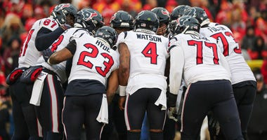 The Houston Texans huddle during the first half in a AFC Divisional Round playoff football game against the Kansas City Chiefs at Arrowhead Stadium.