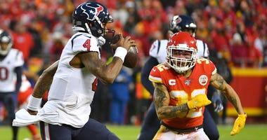 Texans quarterback Deshaun Watson (4) as Kansas City Chiefs strong safety Tyrann Mathieu (32) defends during the AFC Divisional Round playoff football game at Arrowhead Stadium.