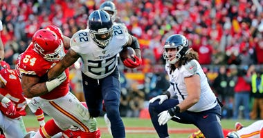 Kansas City Chiefs defensive tackle Mike Pennel (64) tackles Tennessee Titans running back Derrick Henry (22) during the second half in the AFC Championship Game at Arrowhead Stadium.