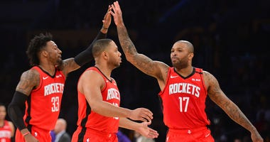 Houston Rockets forward Robert Covington (33) and forward P.J. Tucker (17) celebrate the three point basket scored by guard Eric Gordon (10) against the Los Angeles Lakers during the second half at Staples Center.