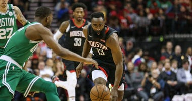 Boston Celtics guard Kemba Walker (8) attempts to get the ball from Houston Rockets guard James Harden (13) during the first quarter at Toyota Center.