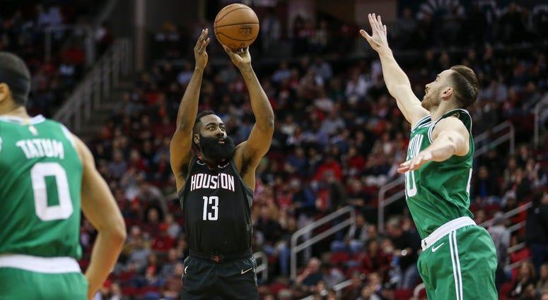 Houston Rockets guard James Harden (13) shoots the ball as Boston Celtics forward Gordon Hayward (20) defends during the first quarter at Toyota Center.