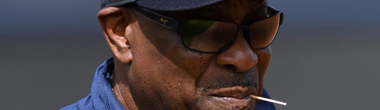 Houston Astros manager Dusty Baker looks over his team during the morning spring training workout.