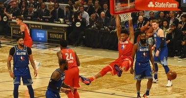 Team Giannis forward Giannis Antetokounmpo of the Milwaukee Bucks dunks in the 2020 NBA All Star Game at United Center.