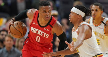 Houston Rockets guard Russell Westbrook (0) dribbles the ball while being defended by Golden State Warriors guard Damion Lee (1) during the fourth quarter at Chase Center.