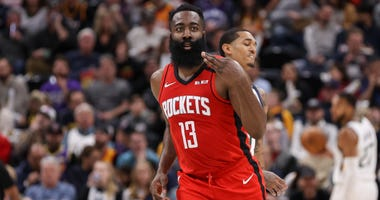 Houston Rockets guard James Harden (13) holds up three fingers after making a three point basket against the Utah Jazz at Vivint Smart Home Arena. The Rockets won 120-110.