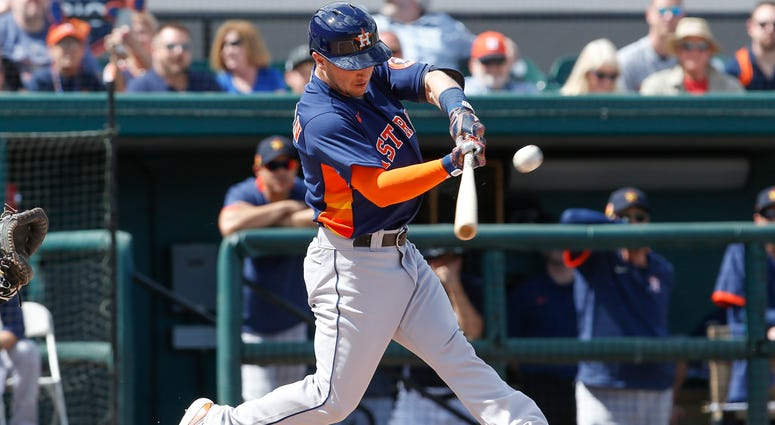 Houston Astros third baseman Alex Bregman (2) doubles to right-center field against the Detroit Tigers during the first inning at Publix Field at Joker Marchant Stadium.