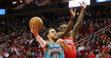;Memphis Grizzlies guard Tyus Jones (21) drives against Houston Rockets forward Robert Covington (33) in the second half at Toyota Center.