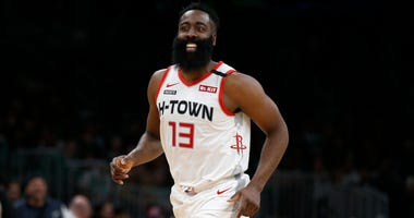 Houston Rockets guard James Harden (13) smiles after scoring against the Boston Celtics during the second half at TD Garden.
