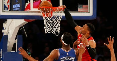 Houston Rockets guard Russell Westbrook (0) dunls the ball against New York Knicks center Mitchell Robinson (23) during the second half at Madison Square Garden.