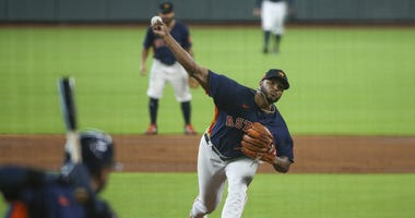 Houston Astros relief pitcher Josh James (39) pitches in an intrasquad game during workouts at Minute Maid Park.
