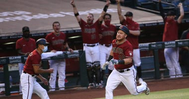Diamondbacks' Kole Calhoun (56) heads to home on an inside-the-park two-run home run against the Houston Astros during the fourth inning at Chase Field.