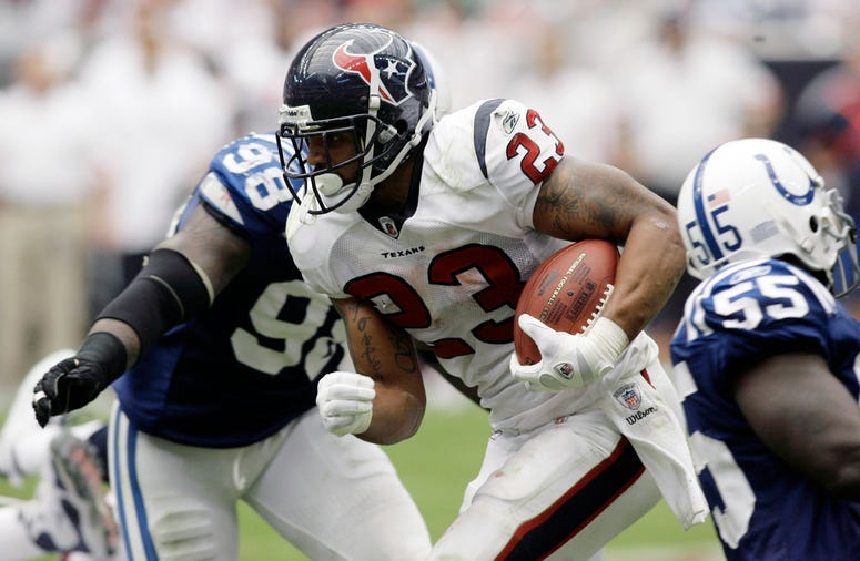 Houston Texans running back Arian Foster (23) runs the ball against the Indianapolis Colts in the fourth quarter at Reliant Stadium. The Texans defeated the Colts 34-24.