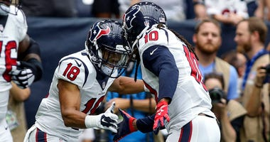 Houston Texans wide receiver DeAndre Hopkins (10) celebrates with wide receiver Cecil Shorts (18) after scoring a touchdown during the first quarter against the Kansas City Chiefs at NRG Stadium.