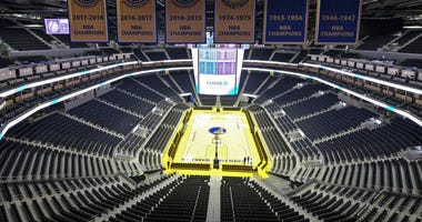 he Golden State Warriors championship banners hang above the seating and basketball court at the Chase Center in San Francisco. The Warriors will play the Brooklyn Nets at home Thursday night, March 12, 2020, in the first NBA game without fans.