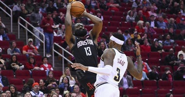 Houston Rockets guard James Harden (13) shoots as Denver Nuggets forward Torrey Craig defends during the second half of an NBA basketball game, Tuesday, Dec. 31, 2019, in Houston.