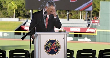Baseball commissioner Rob Manfred pauses before answering a question about the Houston Astros, during a news conference at the Atlanta Braves' spring training facility Sunday, Feb. 16, 2020, in North Port, Fla.