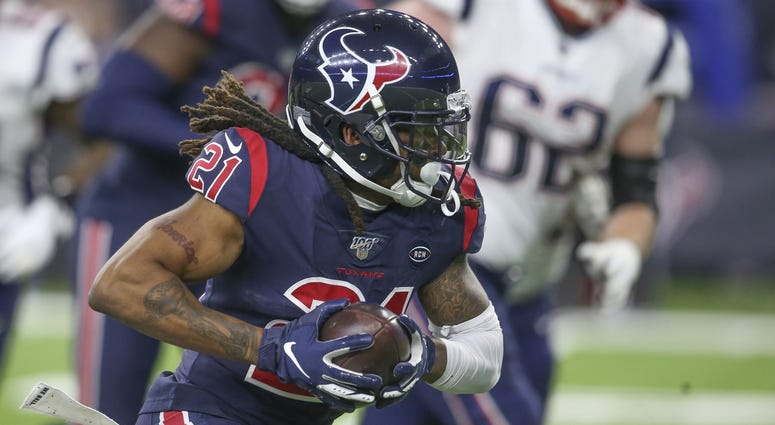 Bradley Roby returns an interception in the first quarter against the Patriots