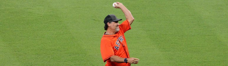 Houston Astros former player Lance Berkman throws out a ceremonial first pitch before game one of the 2019 ALDS playoff baseball series between the Houston Astros and the Tampa Bay Rays at Minute Maid Park.