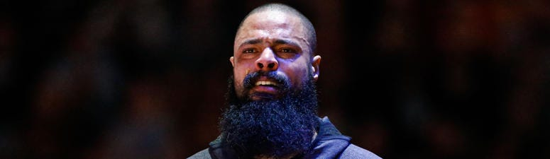 Tears stream down the face off Houston Rockets center Tyson Chandler (19) before the game against the Denver Nuggets at the Pepsi Center.