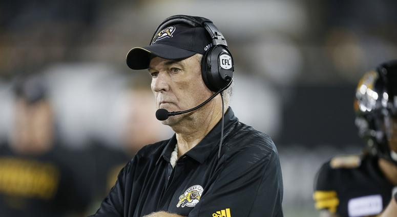 June Jones with the Tiger Cats