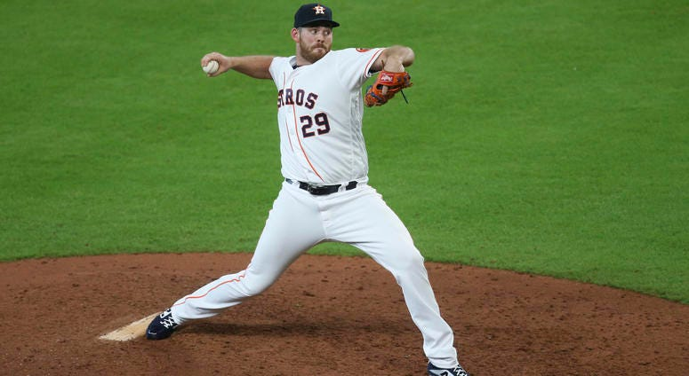 Houston Astros relief pitcher Joe Biagini (29) pitches against the Colorado Rockies in the eighth inning at Minute Maid Park.