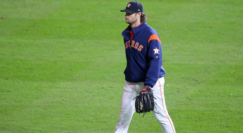 Houston Astros pitcher Gerrit Cole makes his way to the bullpen during the fifth inning in game seven of the 2019 World Series against the Washington Nationals at Minute Maid Park.