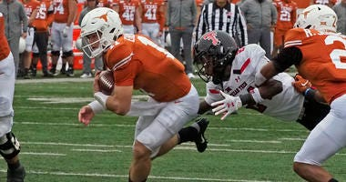 Texas quarterback Sam Ehlinger (11) runs for a touchdown during the first half of an NCAA college football game against Texas Tech, Friday, Nov. 29, 2019, in Austin.