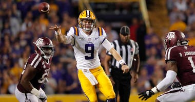 LSU quarterback Joe Burrow (9) throw a pass during the first half of the team's NCAA college football game against Texas A&M in Baton Rouge, La., Saturday, Nov. 30, 2019.