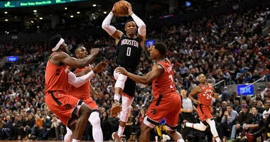 ouston Rockets guard Russell Westbrook (0) controls the ball between Toronto Raptors' defenders, left to right, Terence Davis, Serge Ibaka and Kyle Lowry during second half NBA action in Toronto on Thursday, Dec. 5, 2019.
