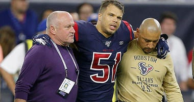 Linebacker Dylan Cole #51 of the Houston Texans is escorted off the field during the game against the Indianapolis Colts at NRG Stadium on November 21, 2019 in Houston.