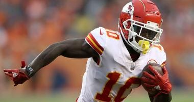 Tyreek Hill runs with the ball for the Kansas City Chiefs in 2018.
