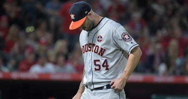 Houston Astros pitcher Mike Fiers (54) reacts in the fourth inning against the Los Angeles Angels at Angel Stadium of Anaheim.