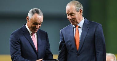 Major League Baseball commissioner Rob Manfred reacts to a ring along with Houston Astros owner Jim Crane during the World Series ring ceremony at Minute Maid Park.
