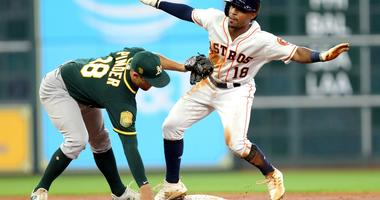 Tony Kemp slides in