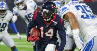 Houston Texans wide receiver DeAndre Carter (14) runs with the ball during the game against the Detroit Lions at NRG Stadium.