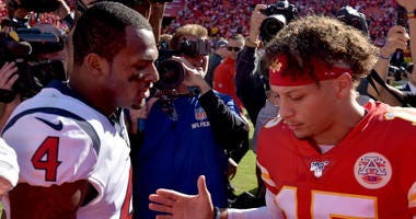 Houston Texans quarterback Deshaun Watson (4) and Kansas City Chiefs quarterback Patrick Mahomes (15) shake hands after the game at Arrowhead Stadium.