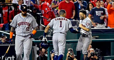 Houston Astros shortstop Carlos Correa (1) celebrates with Houston Astros second baseman Jose Altuve (27) after hitting a two run home run during the fourth inning against the Washington Nationals in game five of the 2019 World Series at Nationals Park.