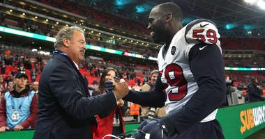 Houston Texans chief executive officer D. Cal McNair (left) shakes hands with outside linebacker Whitney Mercilus (59) after an NFL International Series game against the Jacksonville Jaguars.