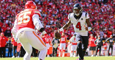 Houston Texans quarterback Deshaun Watson (4) runs against Kansas City Chiefs defensive end Frank Clark (55) at Arrowhead Stadium.