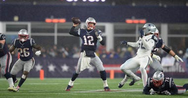 New England Patriots quarterback Tom Brady (12) throws the ball during the second half against the Dallas Cowboys at Gillette Stadium.